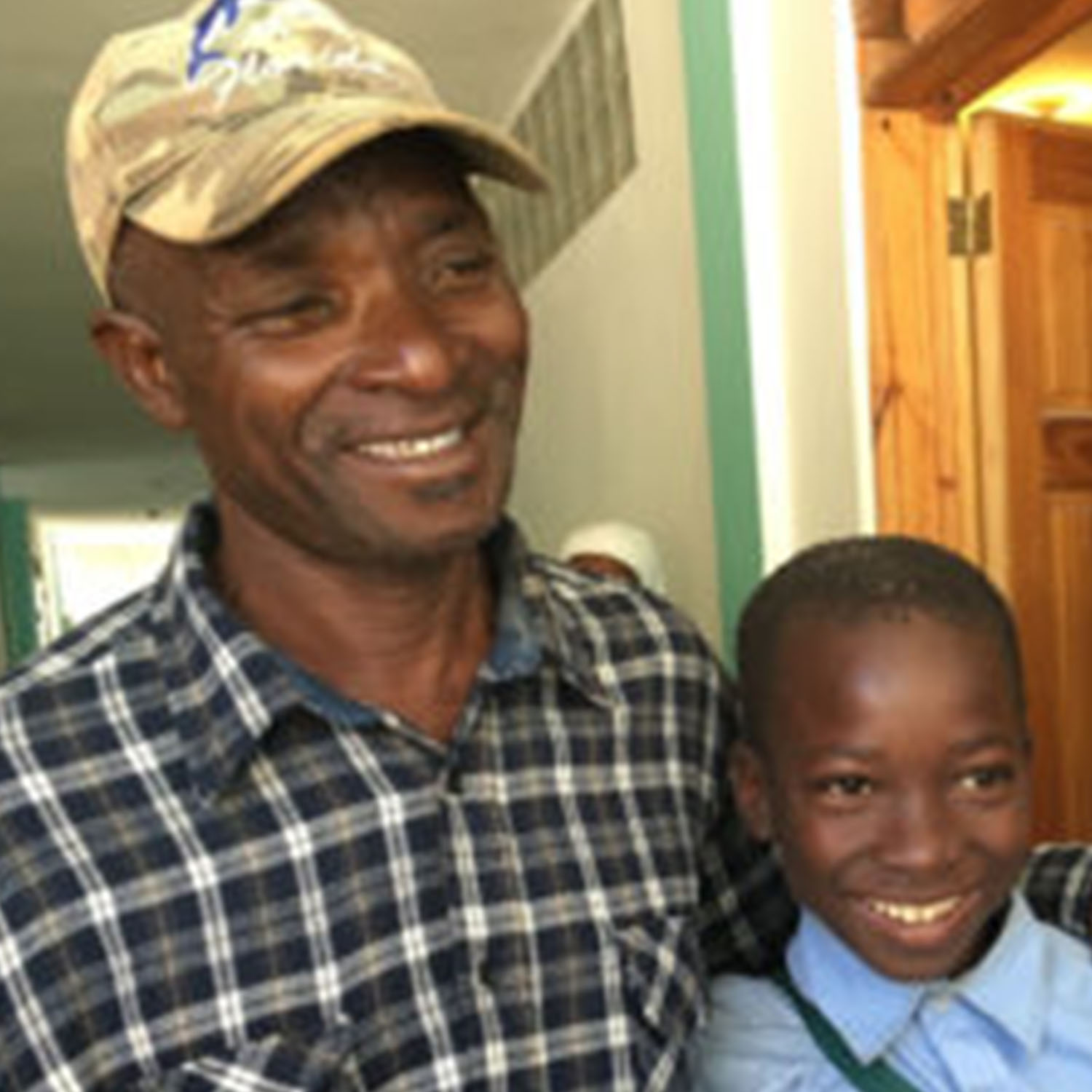 Young Boy Balite And His Father Smiling