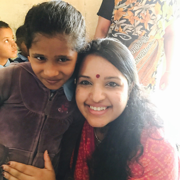 Dr. Luxme Hariharan with little girl