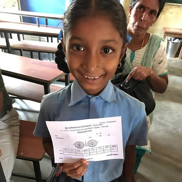 Little girl with eye screening paper