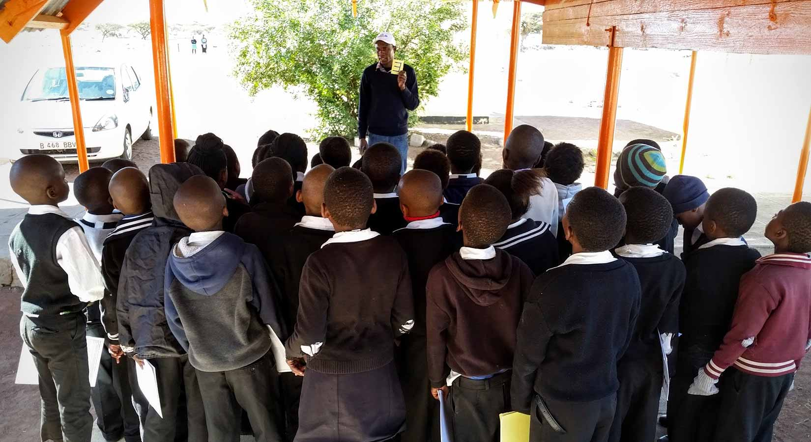 Children in Botswana doing eye test in a group
