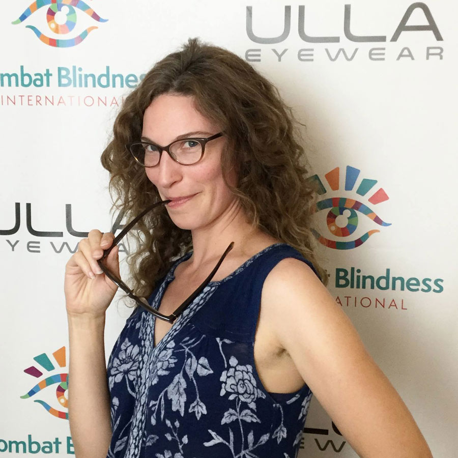 Woman With Glasses In Front Of Ulla Eyewear And CBI Backdrop