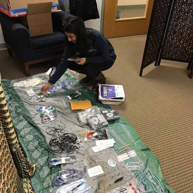 CBI volunteer organizing medical equipment