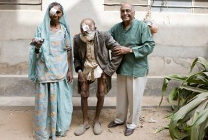 Suresh with older man and woman in India