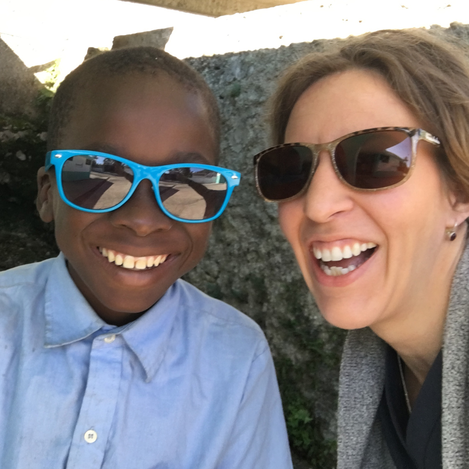 Melissa And Boy Smiling In Sunglasses In Haiti