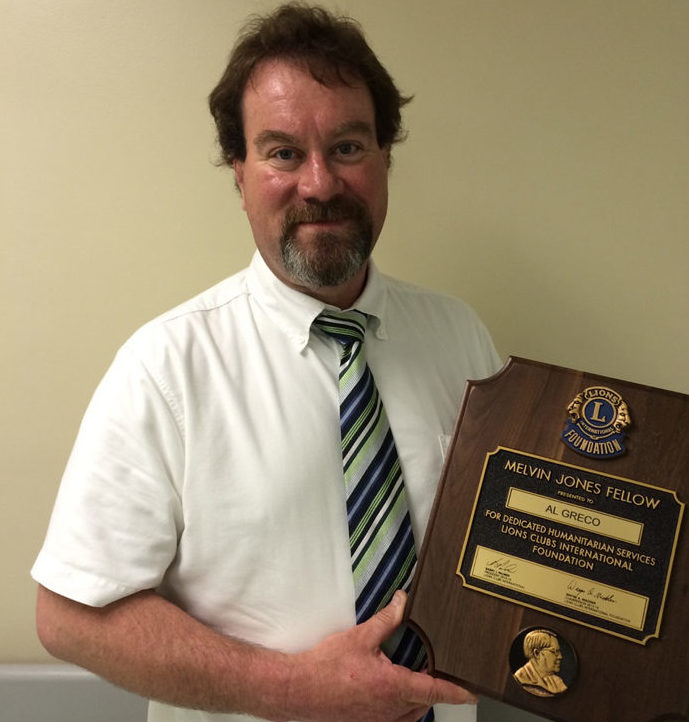Al Greco with his Melvin Jones Fellow plaque.