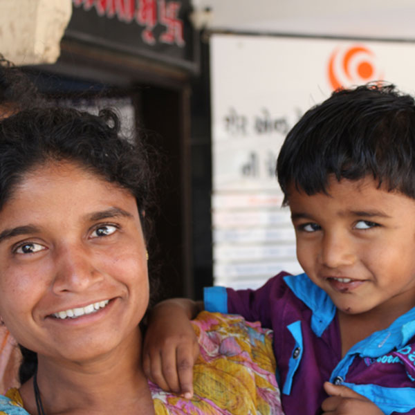 Indian women and child smiling into the camera