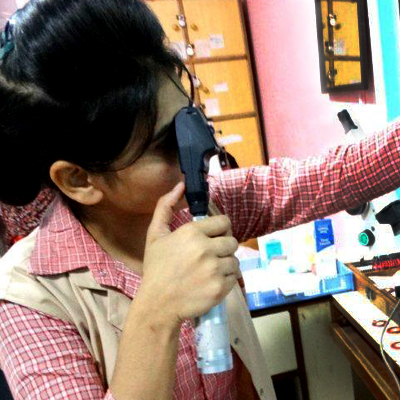Certified Ophthalmic Nurse performing an eye exam