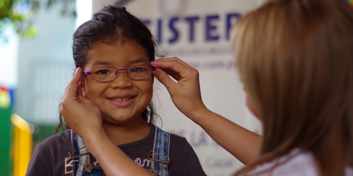 A child in Asuncion, Paraguay, receives glasses supported by CBI.