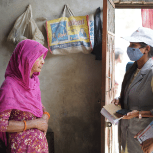 In India, a Shakti worker screens a patient in her home.
